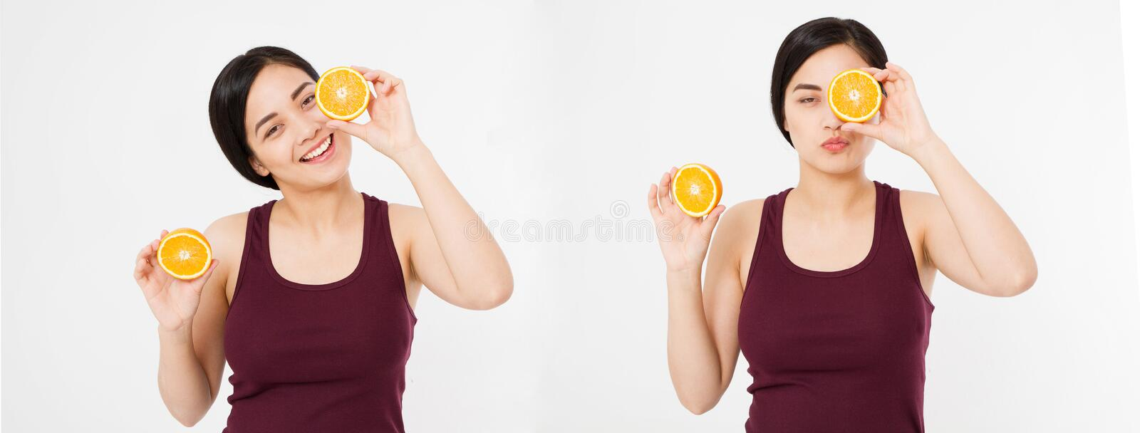Beauty asian japanese woman hold Oranges.Beauty concept. Beautiful Joyful teen girl with freckles, funny red hairstyle and yellow royalty free stock photo