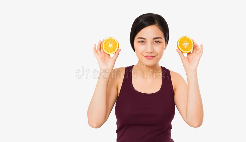 Beauty asian japanese woman hold Oranges.Beauty concept. Beautiful Joyful teen girl with freckles, funny red hairstyle and yellow stock images