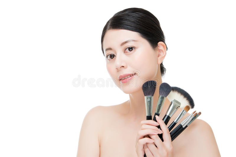Beauty asian portrait smiling woman brunette holding brushes for stock photography