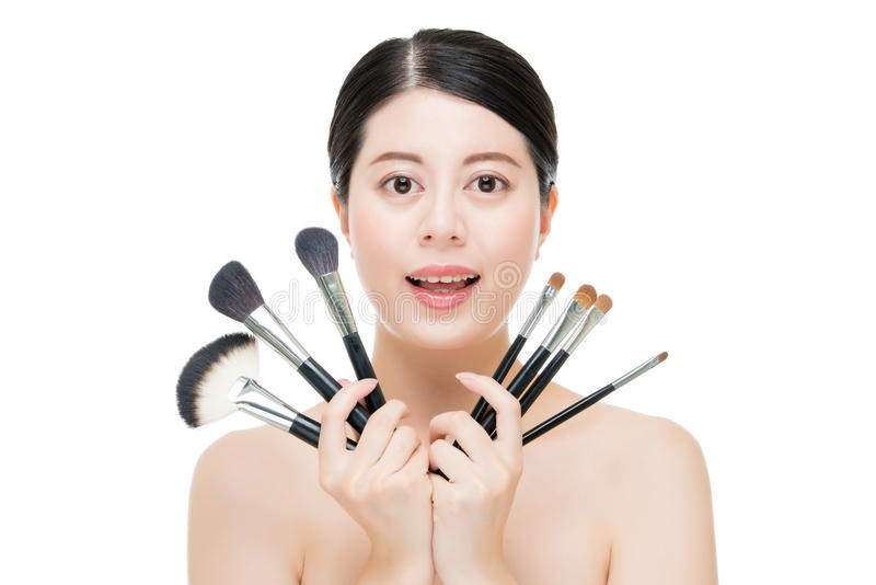 Beauty asian portrait smiling woman brunette holding brushes for royalty free stock photography