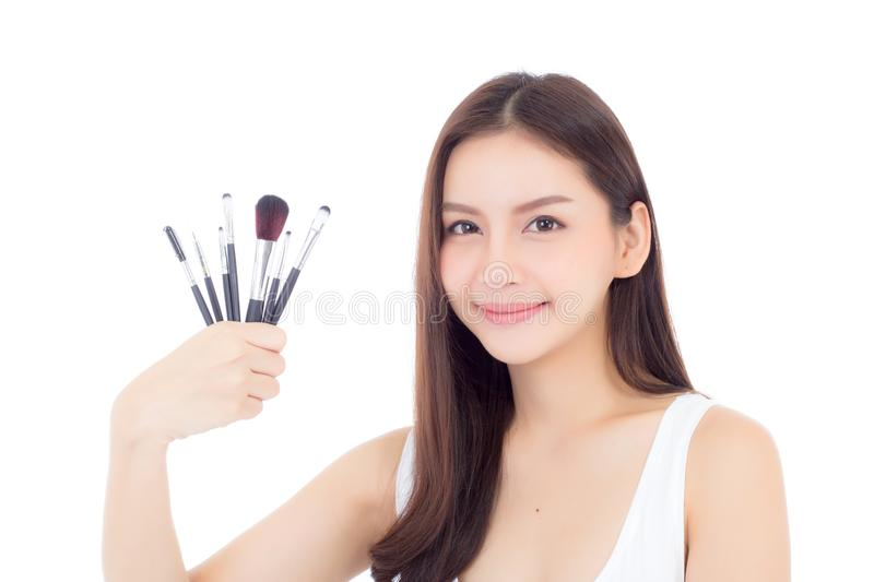 Beauty asian woman applying make up with brush on hand isolated on white background. Beauty asian woman applying make up with brush on hand isolated on white royalty free stock image