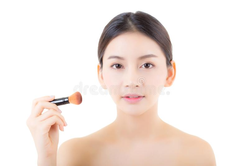 Beauty asian woman applying make up with brush isolated. On white background, health clean skin concept royalty free stock photos