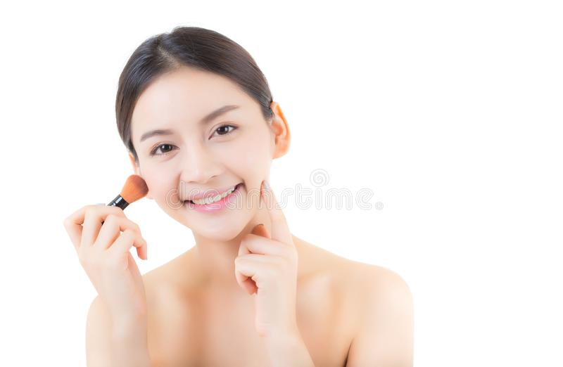 Beauty asian woman applying make up with brush isolated. On white background, health clean skin cosmetics concept royalty free stock photo