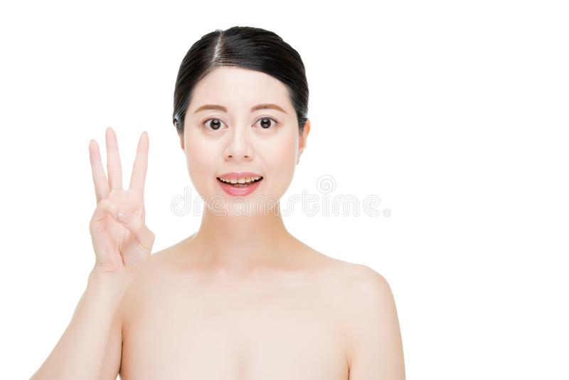 Beauty asian woman count with finger gesture royalty free stock image