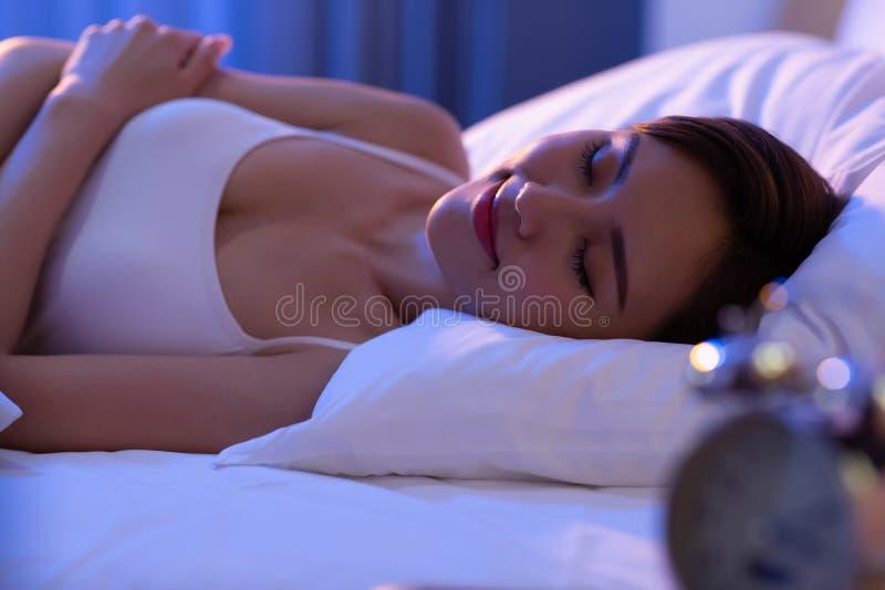 Woman sleep well on bed stock photography