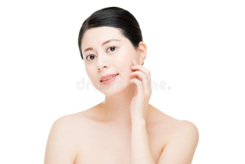 Beauty asian woman model hand touch perfect skin face stock photography