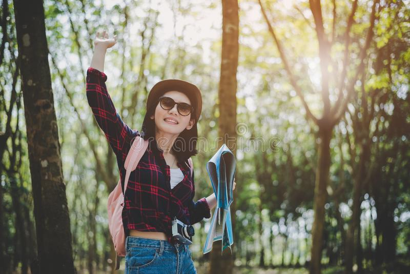 Beauty Asian woman travel in forest with map. Outdoors and Leisure concept. Lifestyle and Happy life theme. Asia travel theme stock images
