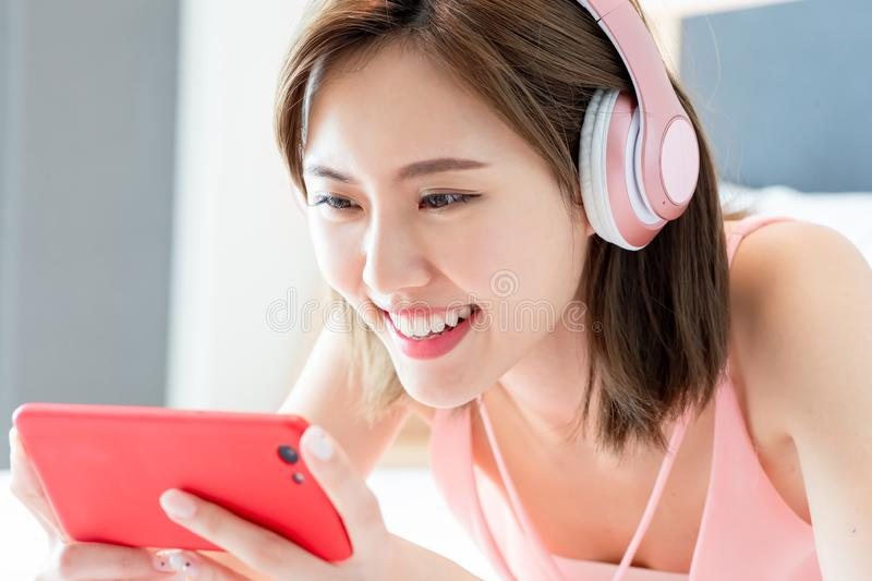 Woman watch video by smartphone stock photo