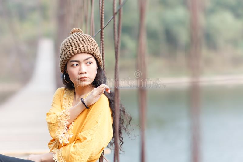 Woman on the wooden bridge stock images
