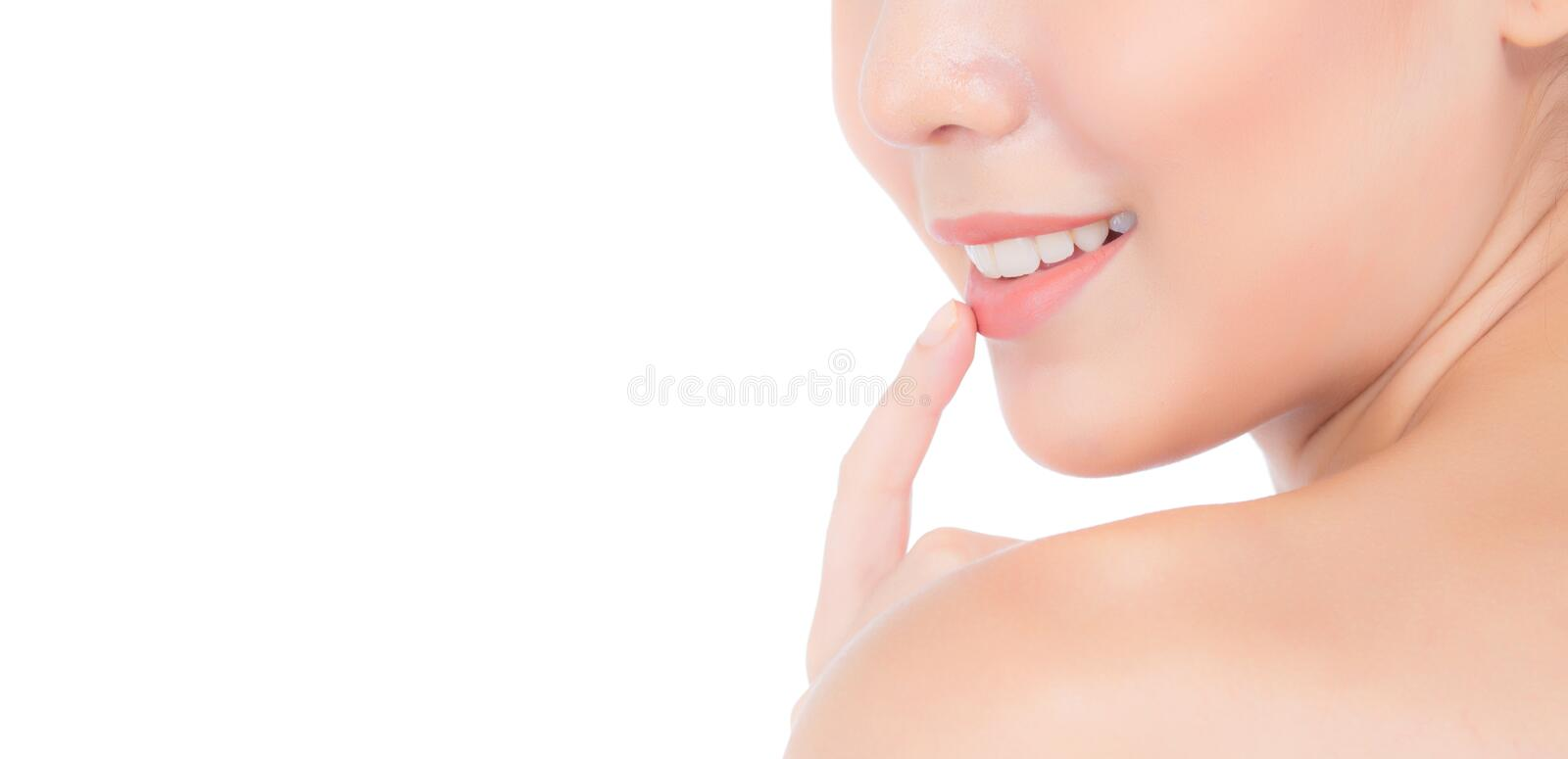 Beauty asian young woman with clean fresh skin touch lips. Cosmetic, beauty and spa concept. royalty free stock images