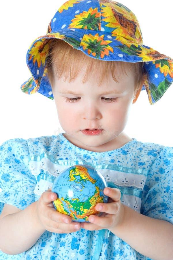 Beauty baby with globe stock image