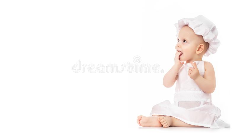 Beauty baby on white background. little sweet cook. Little baker royalty free stock photo