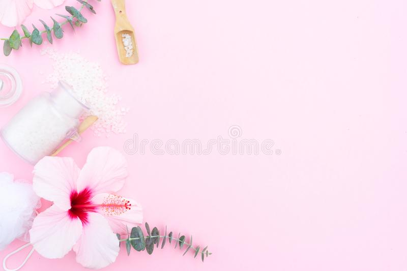 Beauty background with a natural soap, cream, towels and hibiscus flowers royalty free stock photos