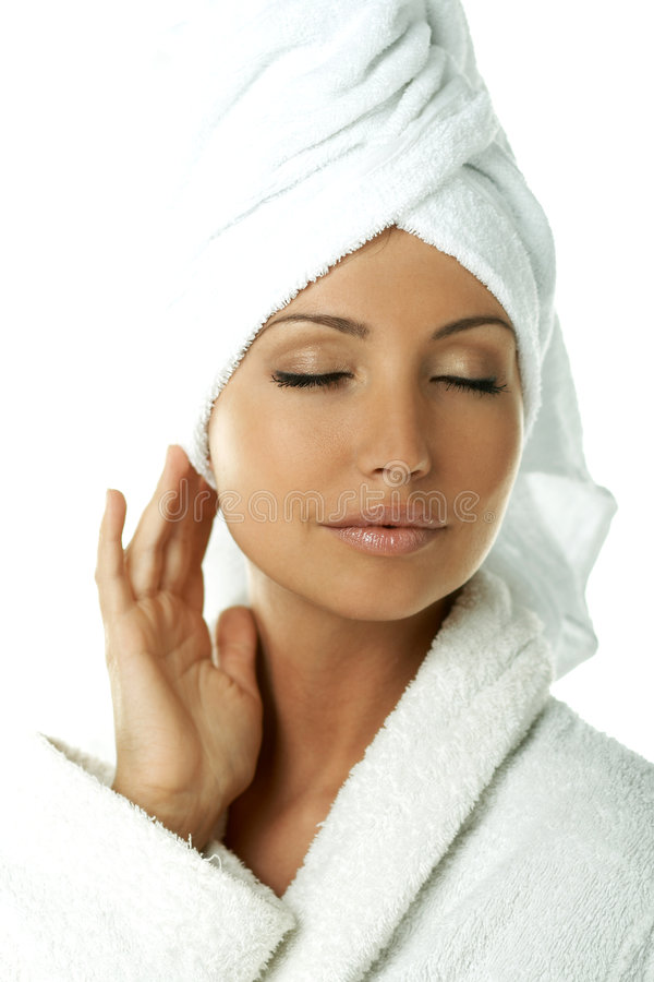 Beauty After Bath. Portrait of Fresh and Beautiful brunette woman wearing white towel on her head royalty free stock photography