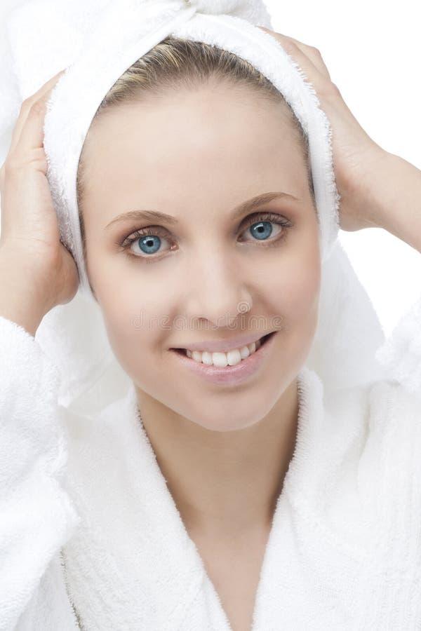 Beauty with bathrobe and towel on head stock photography