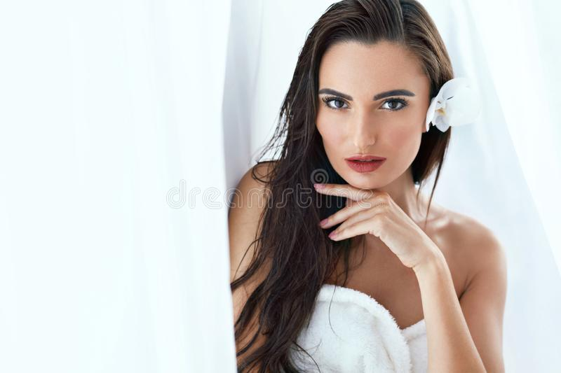 Beauty. Beautiful Woman With Orchid Flower At Spa stock photos
