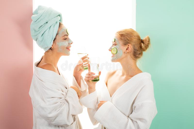 Beauty begins from inside. Spa and wellness. Girls friends sisters making clay facial mask. Anti age mask. Stay. Beautiful. Skin care for all ages. Women having royalty free stock images