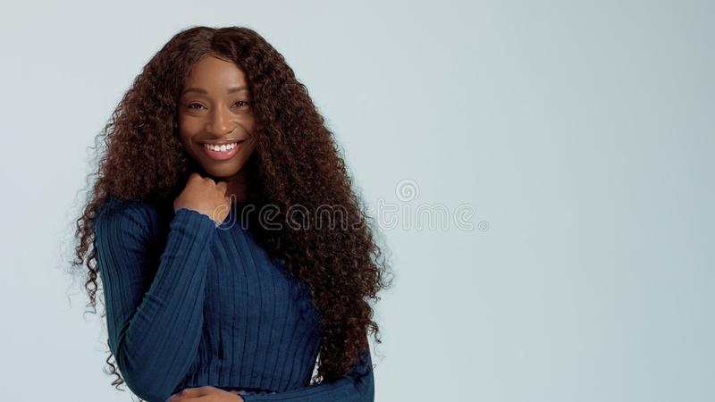 Beauty black mixed race african american woman with long curly hair and perfect smile stock image