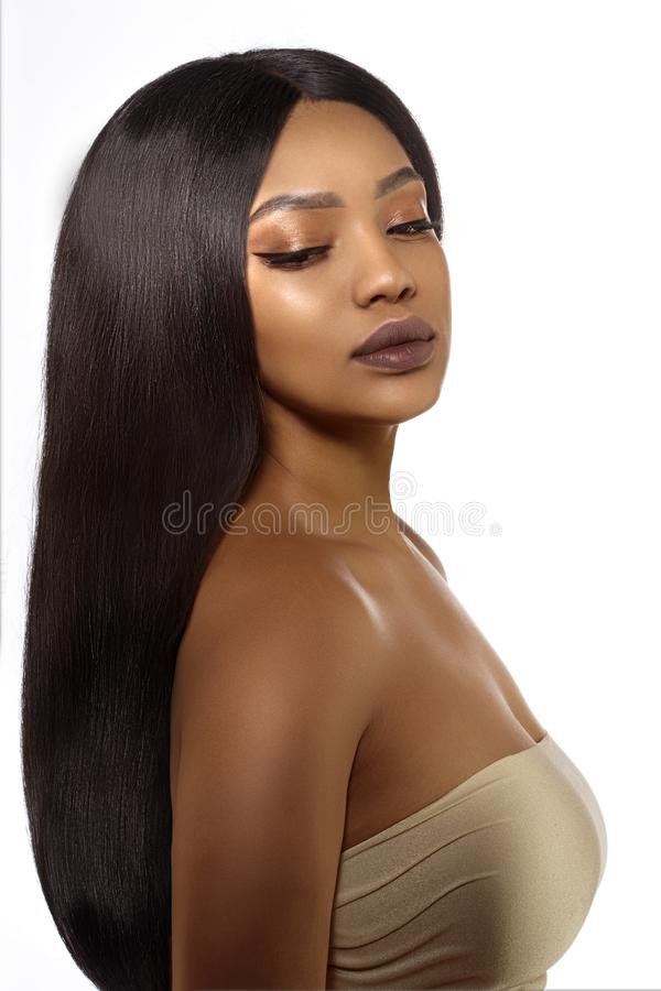 Beauty black skin woman in spa. African Ethnic female face. Young african american model with long hair royalty free stock photo