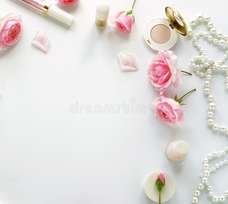 Beauty blog concept. Female make up accessories and roses royalty free stock photos