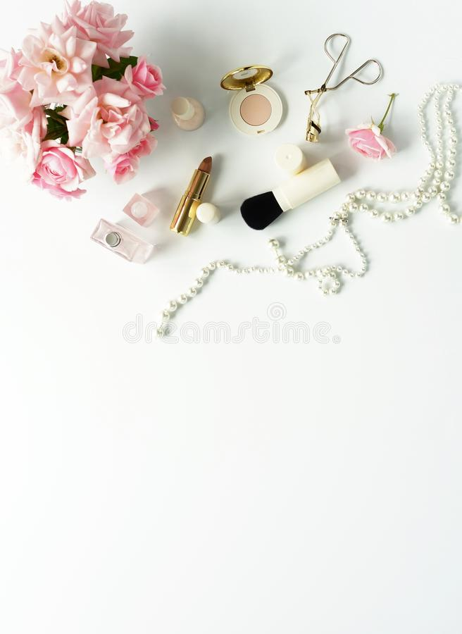 Beauty blog concept. Female make up accessories and roses royalty free stock photo