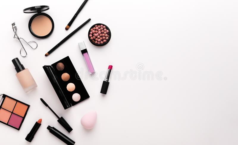 Luxury makeup products creating frame on white stock photography