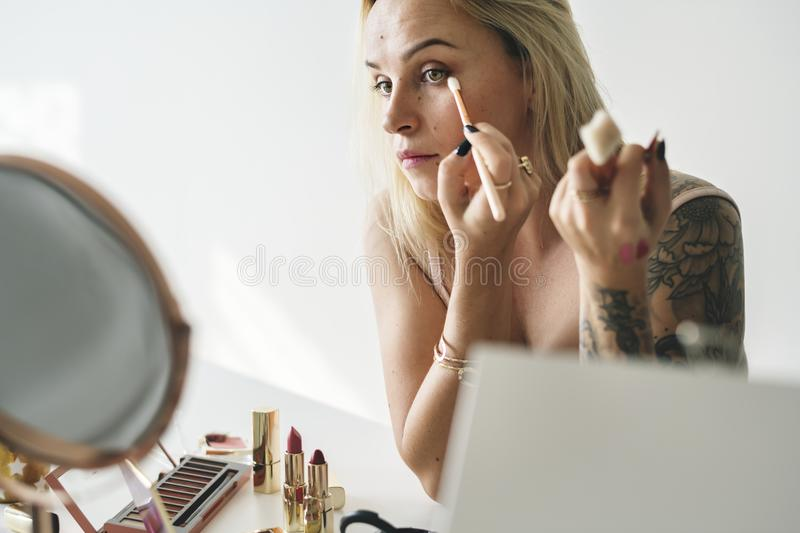 Beauty blogger doing makeup tutorial royalty free stock photography