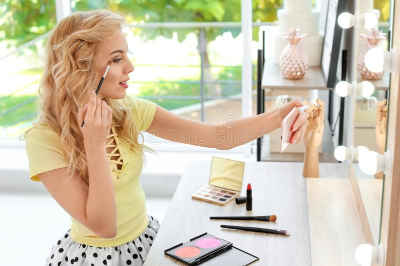 Beauty blogger filming makeup tutorial with smartphone stock images