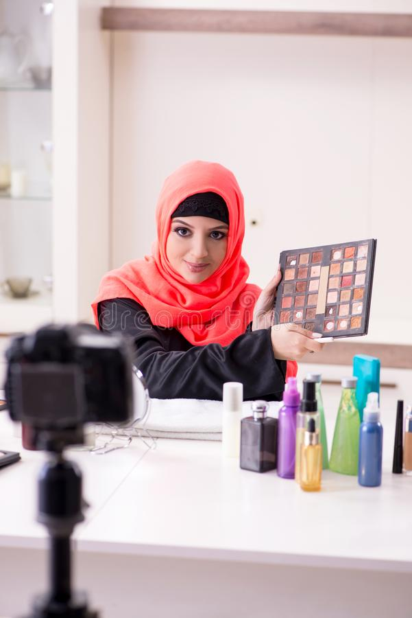 Beauty blogger in hijab recording video for her blog. The beauty blogger in hijab recording video for her blog royalty free stock photo