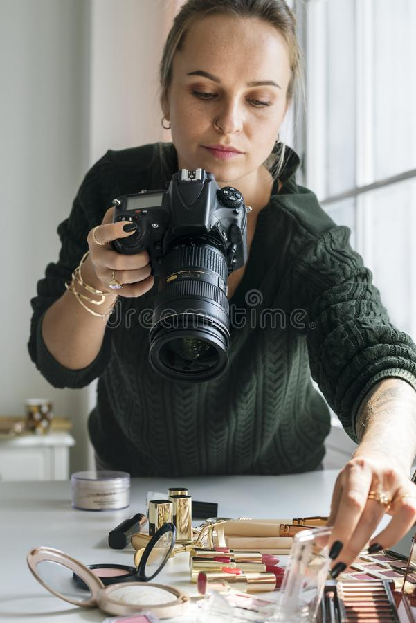 Beauty blogger taking photo of cosmetics royalty free stock image