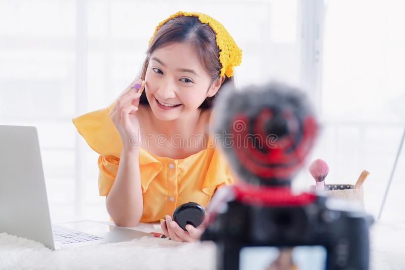 Beauty blogger young Asian woman presentation training makeup skincare video live recording stock photography