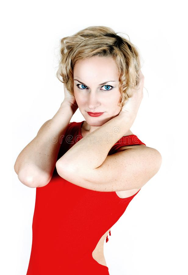 Beauty blond in red dress royalty free stock image