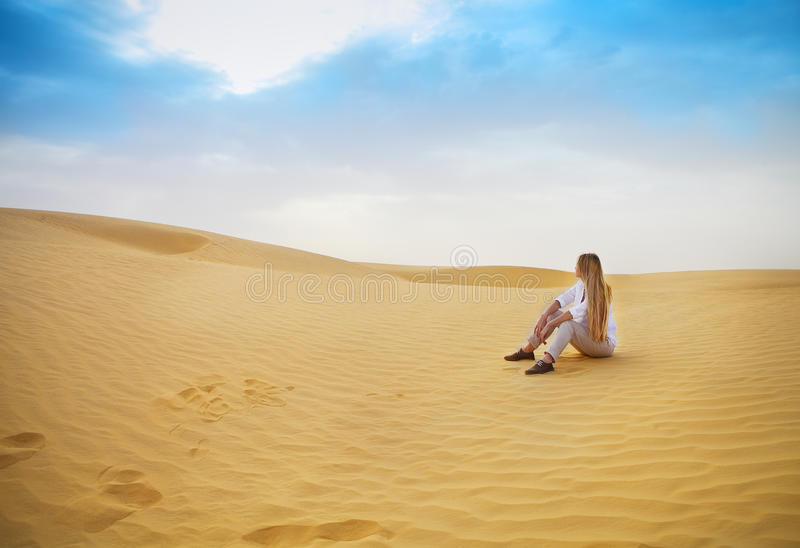 Beauty blond woman in desert. Sahara desert. Douz, Tunisia royalty free stock photos