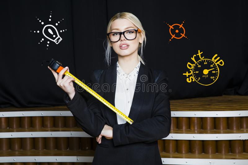 Download Beauty Blonde Businesswoman With Designer Or Architect Staff Is  Standing Against Concrete Wall With Startup