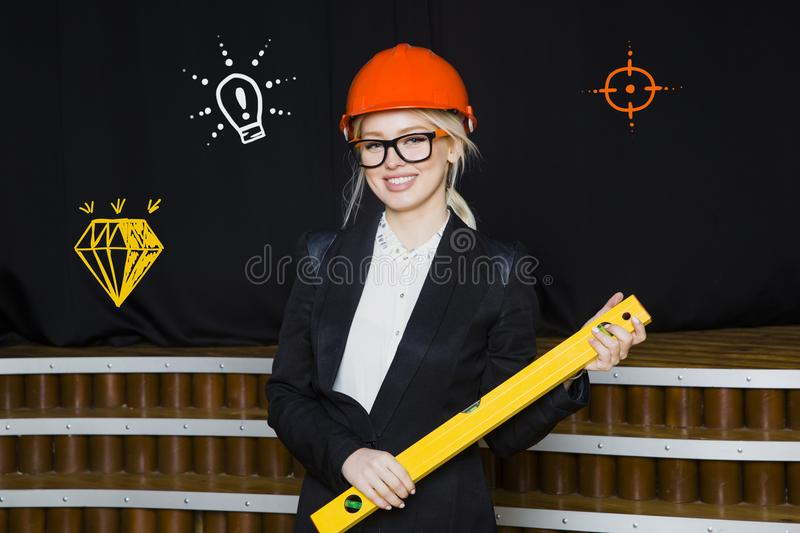 Superior Download Beauty Blonde Businesswoman With Designer Or Architect Staff Is  Standing Against Concrete Wall With Startup