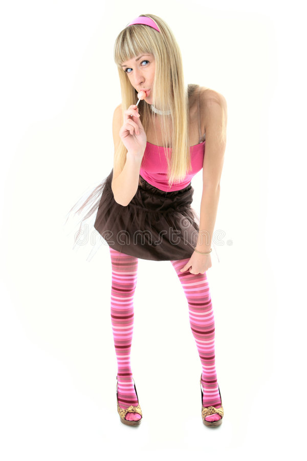 Beauty blonde girl with candy stock image