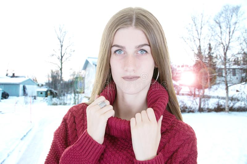 Beauty blonde girl outdoor in winter sweater and snow background royalty free stock images