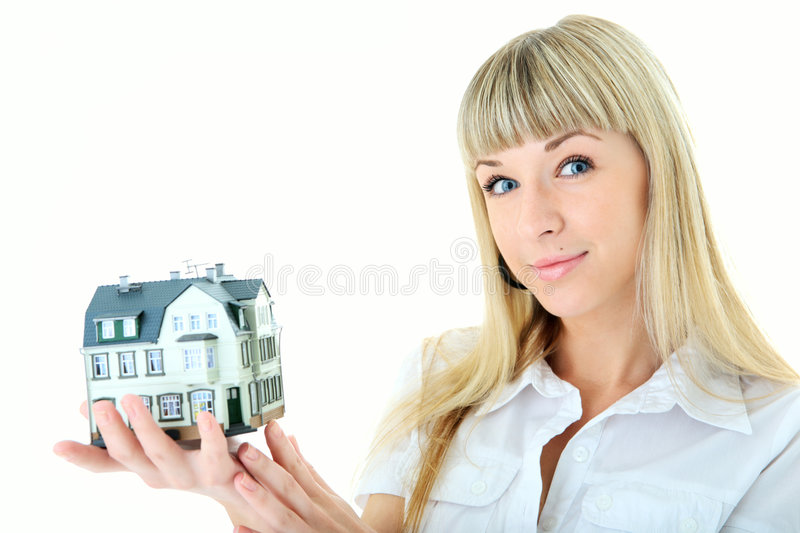 Beauty blonde woman with little house on hand royalty free stock images