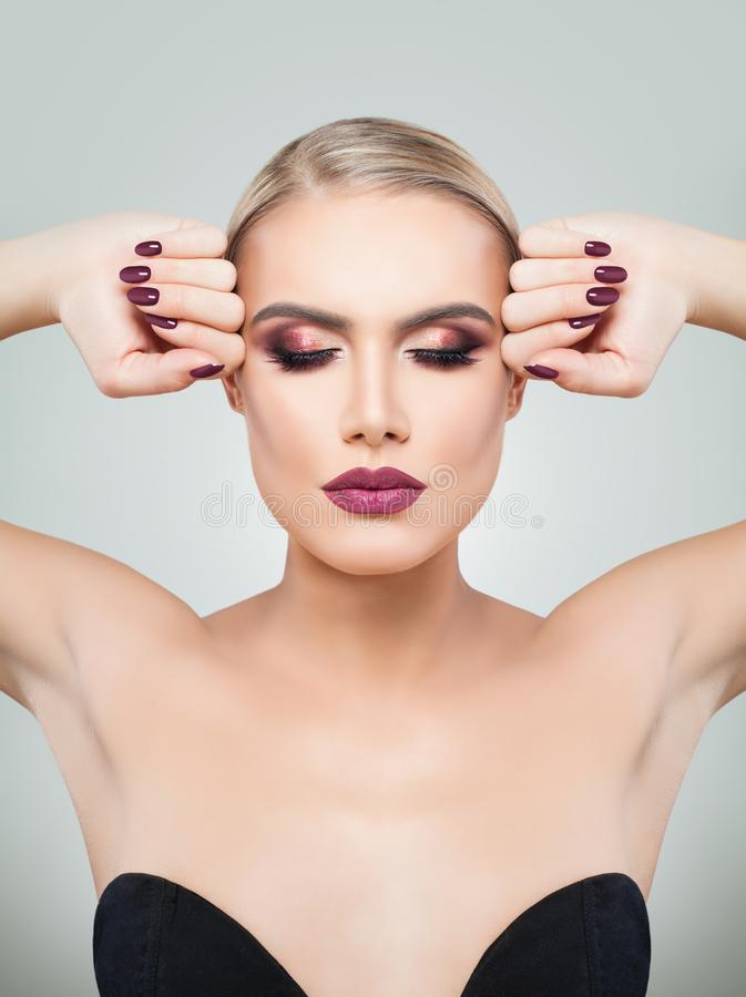 Beauty Blonde Woman with Perfect Professional Holiday Makeup stock photography