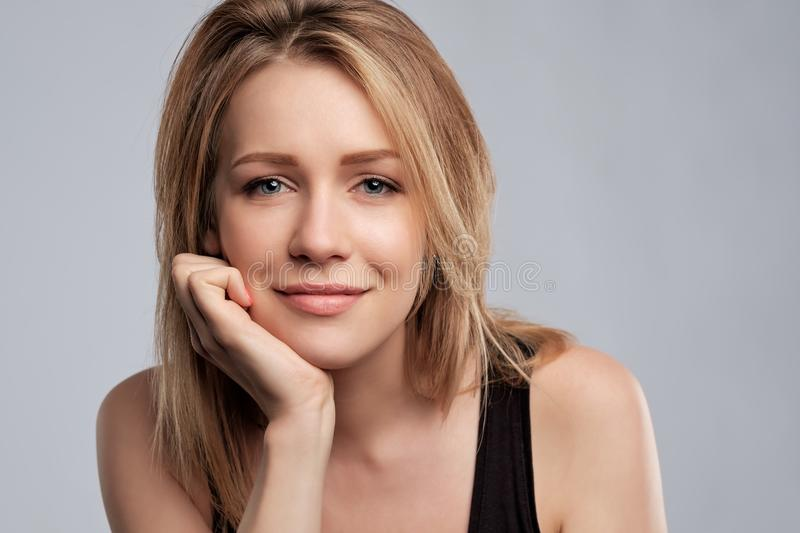 Beauty blonde woman with professional perfect makeup. Looking with confidence at camera stock photography
