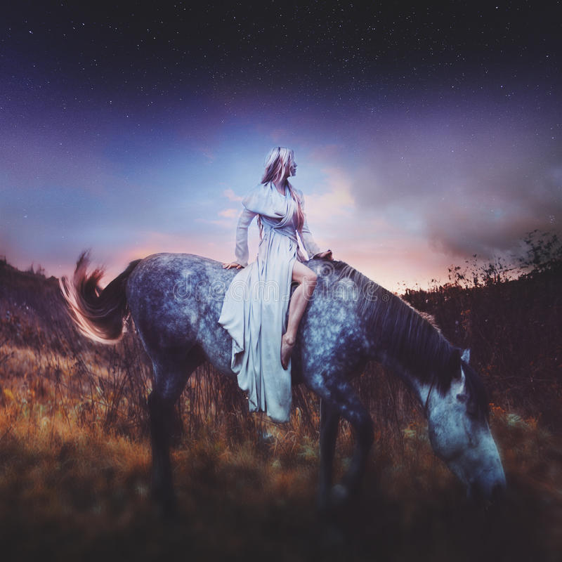 Beauty blondie on horseback, amid the fabulous stock photos