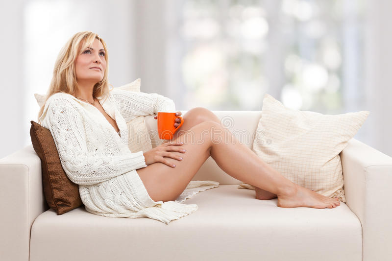 Beauty, blondie woman in a sofa royalty free stock photos