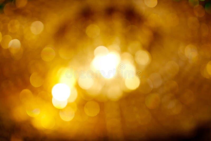 Blurred of gold bokeh light background. Beauty blurred of gold bokeh light background stock image