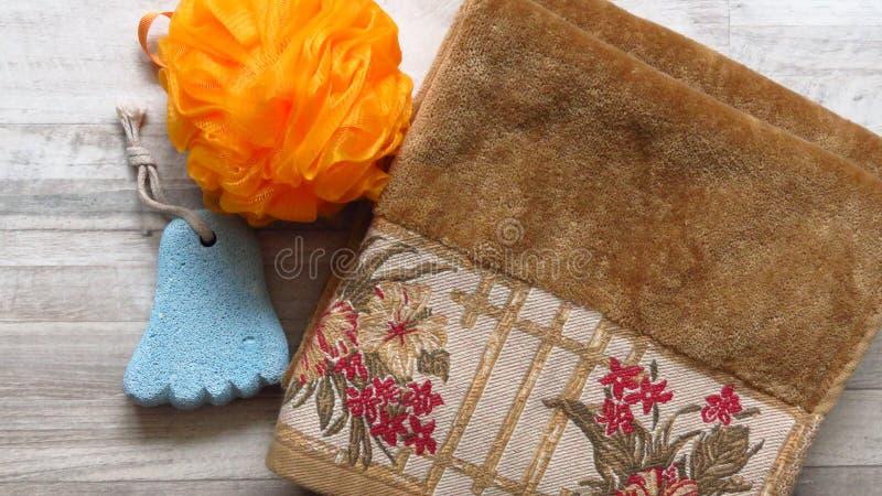Orange Bath Sponge, Foot Shaped Pumice Stone, Ochre Colour Towel. . royalty free stock photos