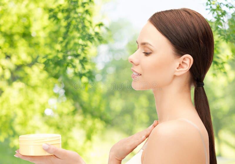 Beautiful woman with moisturizing cream stock photos