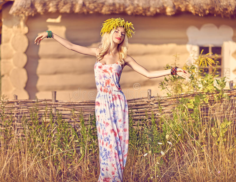 Beauty boho woman in wreath enjoying nature, relax, outdoors stock photos