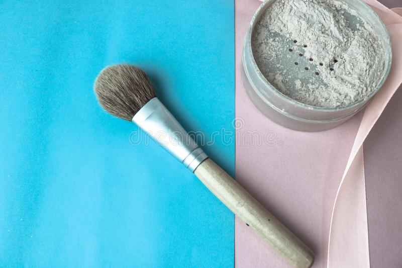 Beauty box, crumbly matte mineral powder with a special brown beautiful wooden brush from natural nap for makeup royalty free stock images