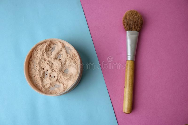 Beauty box, crumbly matte mineral powder with a special brown beautiful wooden brush from natural nap for makeup stock photo
