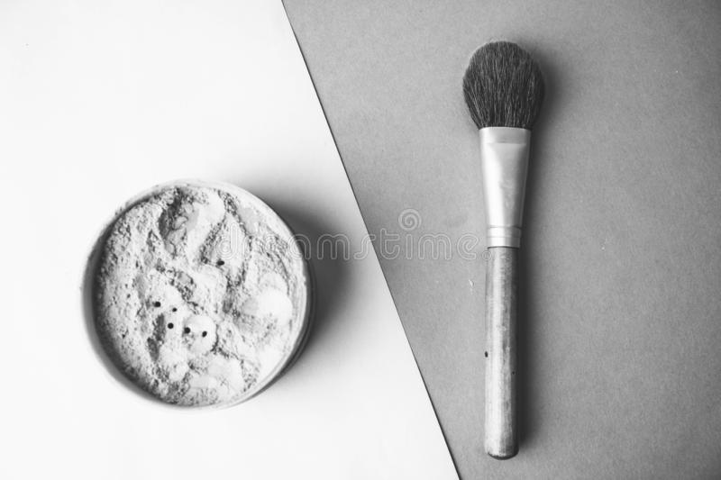 Beauty box, crumbly matte mineral powder with a special brown beautiful wooden brush from natural nap for makeup royalty free stock image