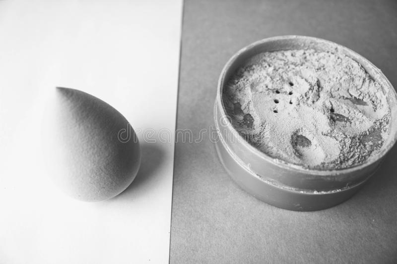 Beauty box, a set of women`s cosmetics, crumbly matte mineral powder and blush with a beauty blender for makeup stock images